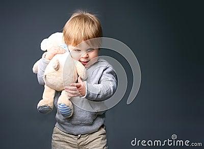 Baby hugging teddybear