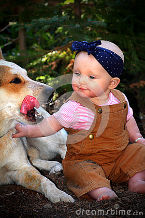 Free Baby In Dirt With Dog Stock Image - 58944791