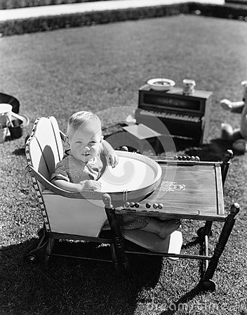 Free Baby In Highchair Outside Stock Image - 52009521