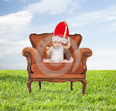 Free Baby In Royal Hat With Lollipop Sitting On Chair Royalty Free Stock Image - 50745946