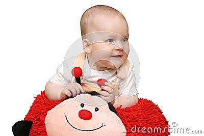 Baby with ladybug pillow