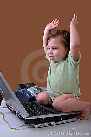 Baby with laptop and arms in air