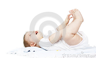 Baby lies on a diaper