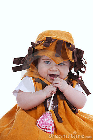 Baby with a lion mask