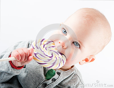 Baby with lollipop