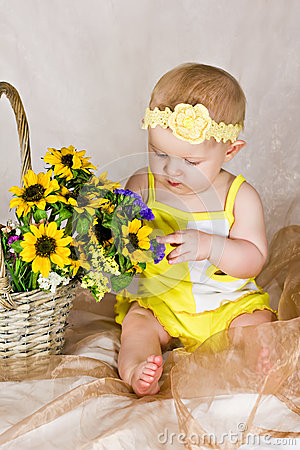 Baby looking at flowers