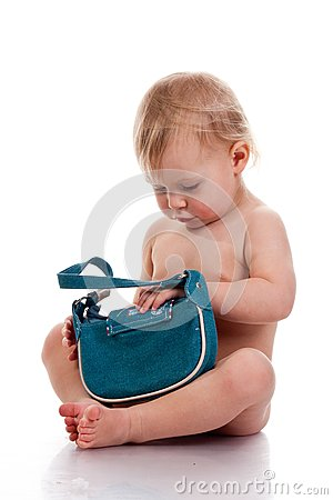 Baby looking into a small bag