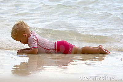 Baby lying on the beach