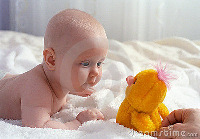 Baby meet with a toy