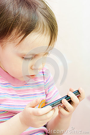 Baby with mobil telephone