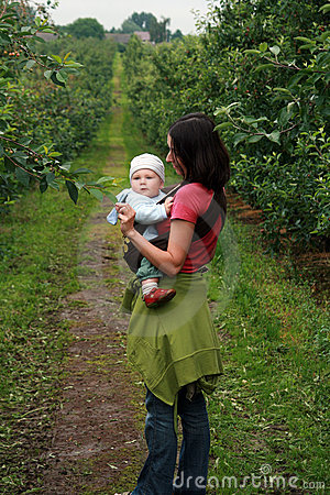Baby with mom in baby carrier