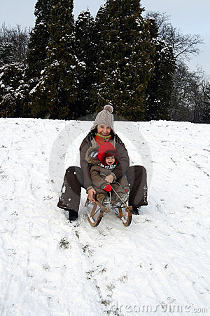 Baby and mom sledding