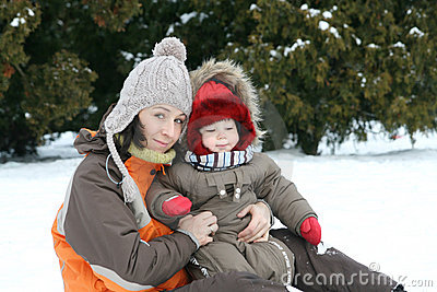 Baby and mom on winter day