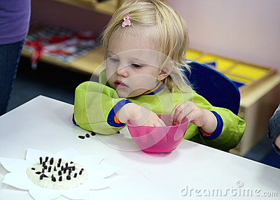 Baby in montessory class