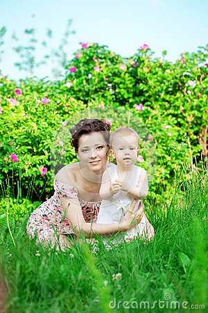 Baby and mother in  park