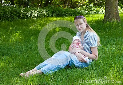 Baby and Mother Sitting in the Grass
