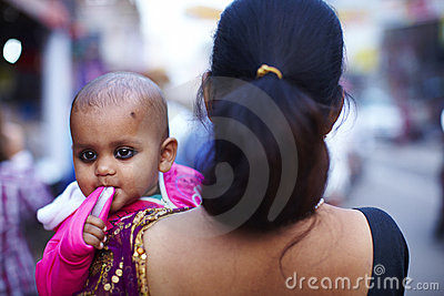 Baby in mothers arms in India Editorial Photography