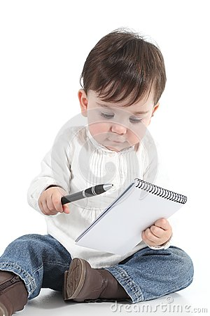 Baby with a notebook and a pen