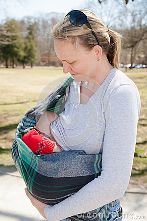 Free Baby Nursing In Sling Stock Photo - 48237690