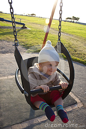 Baby in outdoor swing