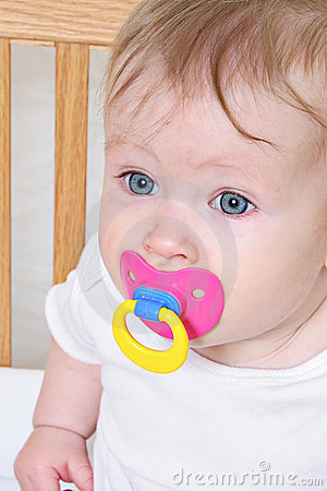 Baby with pacifier or dummy