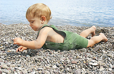 Baby on pebble beach