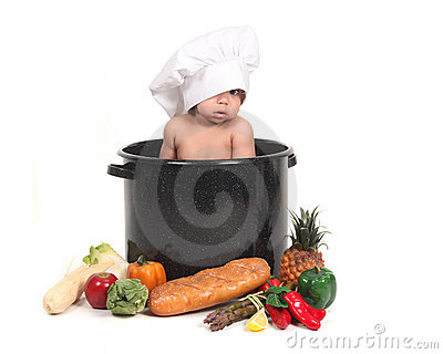 Baby Peeking Through a Chef Hat