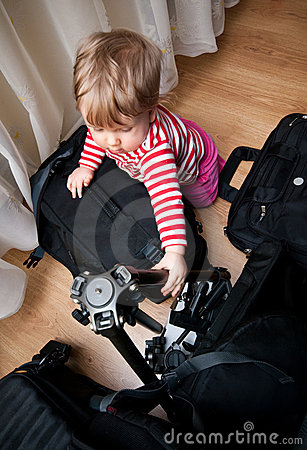 Baby with photography gear