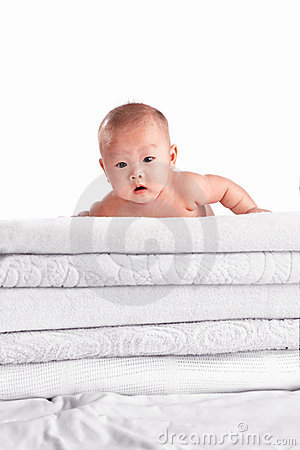 Baby on pile of towel