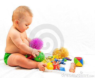 Baby and Pile of Toys