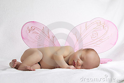 Baby with pink angel wings on white background