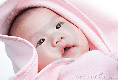 Baby with pink blanket