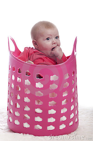 Baby in a pink plastic laundry basket