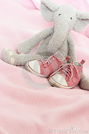 Baby pink shoes and plush elephant