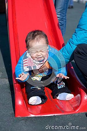 Baby play on slide