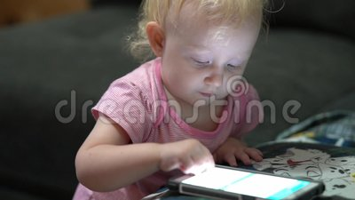 Baby playing with cell phone. Touch screen stock video footage
