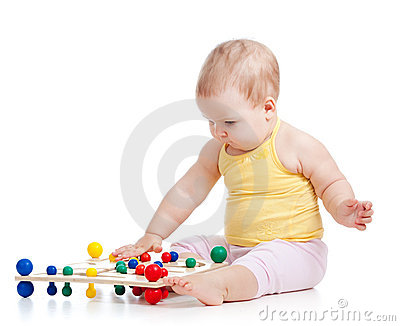 Baby playing with colored toy