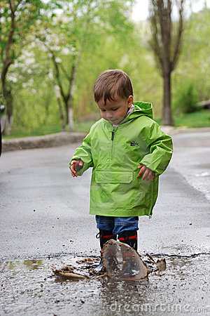 Free Baby Playing In Puddles Royalty Free Stock Image - 10410326