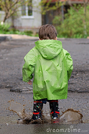 Free Baby Playing In Puddles Royalty Free Stock Images - 10410329