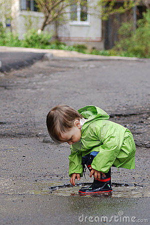 Free Baby Playing In Puddles Stock Images - 10410344