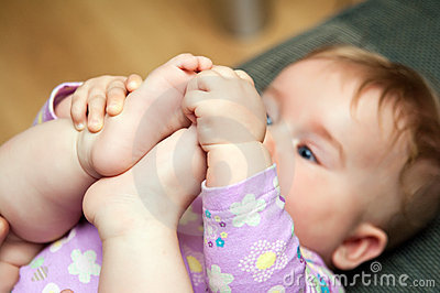 Baby playing with toes