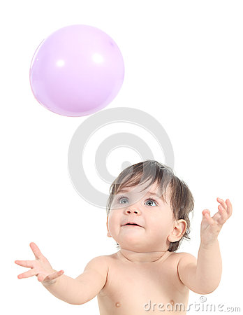 Baby playing and trying to catch a balloon