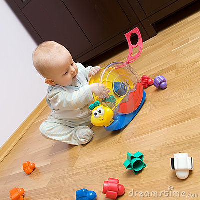 Free Baby Playing With Plastic Toy Royalty Free Stock Image - 8299066
