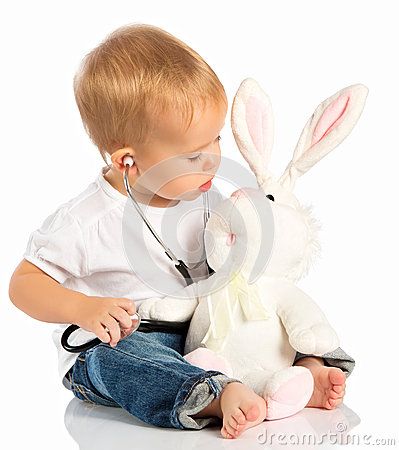 Free Baby Plays In Doctor Toy Bunny Rabbit And Stethoscope Royalty Free Stock Photography - 34694717