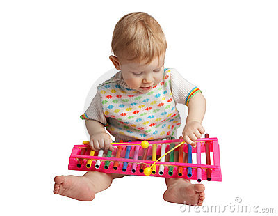 Baby plays musical toy