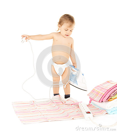 Baby plugging in iron