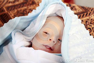 Baby portrait covered with blanket