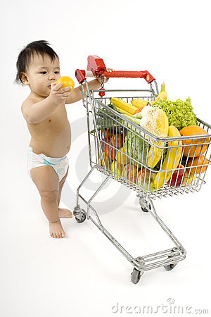 Free Baby Pushes A Shopping Cart Royalty Free Stock Photography - 5217157