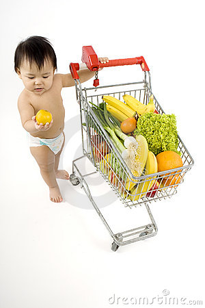 Free Baby Pushes A Shopping Cart Stock Photos - 5217163