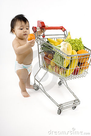 Free Baby Pushes A Shopping Cart Stock Photos - 5217183